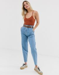 ASOS DESIGN soft peg jeans in light vintage wash with elasticated cinched waist detail