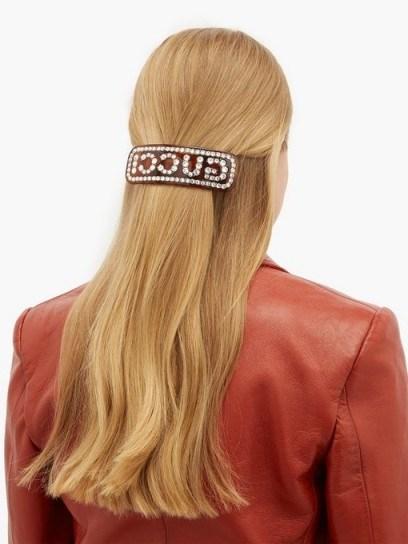 GUCCI Crystal-logo brown resin hair slide | designer accessories - flipped