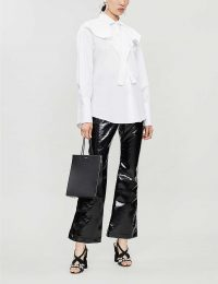 ELLERY Orthodox flared vinyl cotton-blend trousers in black ~ high shine kick-flares