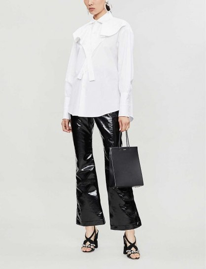 ELLERY Orthodox flared vinyl cotton-blend trousers in black ~ high shine kick-flares - flipped