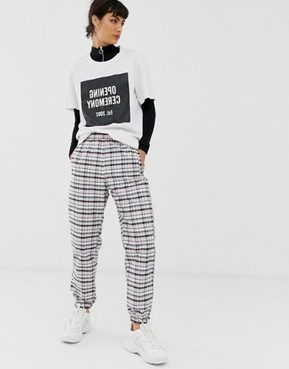 Opening Ceremony nylon sweatpant in check in pink plaid / cuffed sweatpants - flipped