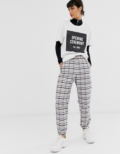 Opening Ceremony nylon sweatpant in check in pink plaid / cuffed sweatpants