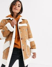 ASOS DESIGN suedette jacket with floral embroidery in tan – borg trimmed jackets