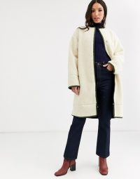 ASOS DESIGN Tall collarless borg coat with seam detail in cream / neutral winter coats