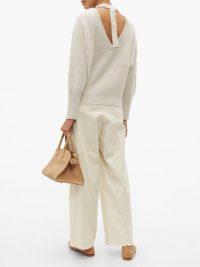 BRUNELLO CUCINELLI Embellished V-back ribbed cashmere sweater in cream