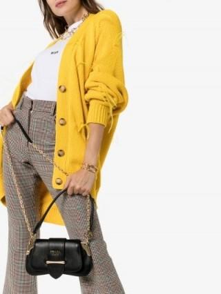 Kaia Gerber small black leather handbag, Prada Sidonie Shoulder Bag, during Fashion Week in Paris, 23 September 2019 | celebrity handbags | models off duty accessories