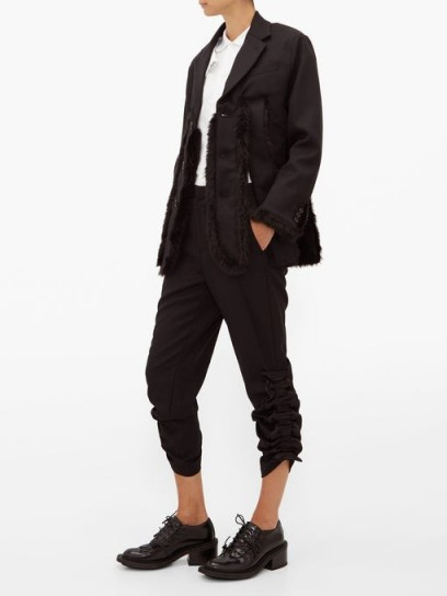 NOIR KEI NINOMIYA Ruched-cuff cropped wool trousers in black | side gathered pants