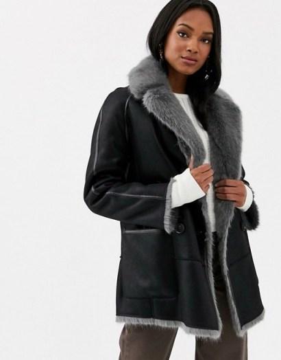 Urbancode reversible faux fur coat in black / grey   luxe winter coats - flipped