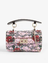 VALENTINO Rockstud Spike leather shoulder bag with 'Your Love Makes Me Feel Free' embroidered slogan in Macaron