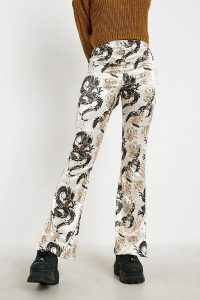 UO Dragon Print Champagne Satin Flare Trousers in Cream