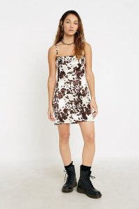 UO Cow Print Sateen Mini Dress in White