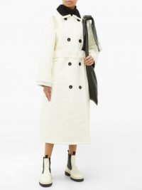 STAND STUDIO Marissa coated-canvas faux-fur lined trench coat in white / chic winter coats