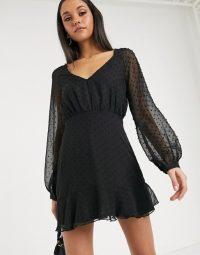 Missguided dobby long sleeve skater dress in black / lbd