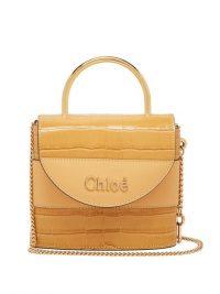 CHLOÉ Aby Lock crocodile-effect leather cross-body bag in beige ~ small luxury top handle handbag