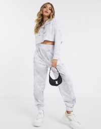 ASOS DESIGN tracksuit raw hem sweat / jogger in tie dye with placement print in grey