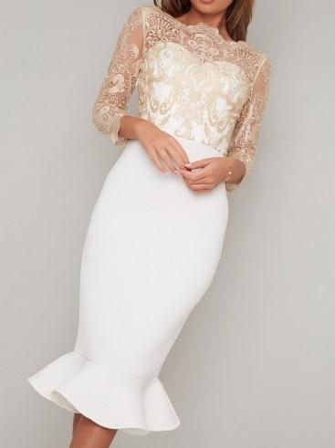 Chi Chi Agape Dress in White | fitted pephem dresses - flipped