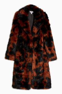 Topshop Cow Print Faux Fur Coat | black and brown animal prints | warm and stylish coats