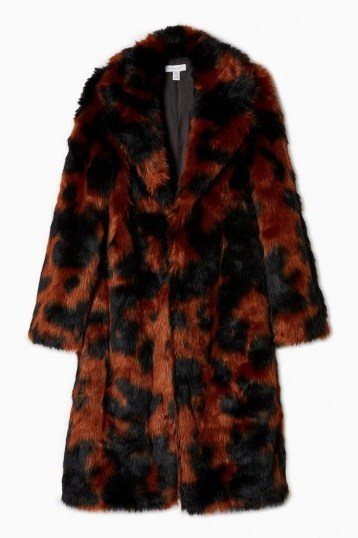 Topshop Cow Print Faux Fur Coat | black and brown animal prints | warm and stylish coats - flipped