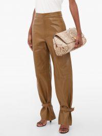 BOTTEGA VENETA Cuffed ankle wide-leg leather trousers in brown