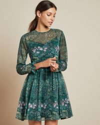 Ted Baker SORELLA Diamond long sleeved mini dress in dark green | feminine fit and flare