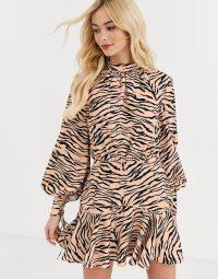 Finders Keepers high neck long sleeve dress in tiger print / flippy hem dresses