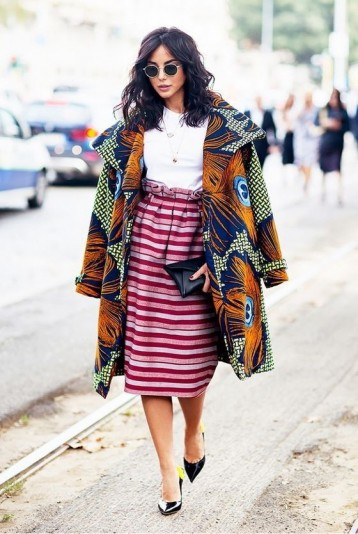 Bold peacock feather print coat and pink striped paperbag waist skirt / outfits you didn't think would work