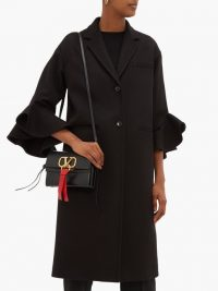 VALENTINO Ruffled-cuff single-breasted wool-blend coat in black ~ chic winter coats
