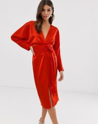 ASOS DESIGN midi dress with batwing sleeve and wrap waist in satin in red | deep V-front party dresses