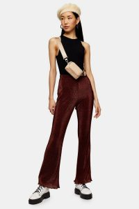 TOPSHOP Rust Spot Plisse Flare Trousers / floaty flares
