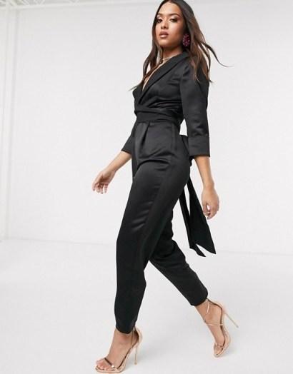 ASOS DESIGN Petite satin wrap tux jumpsuit with peg leg in black | low neckline jumpsuits - flipped