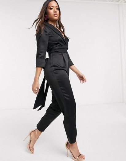 ASOS DESIGN Petite satin wrap tux jumpsuit with peg leg in black | low neckline jumpsuits
