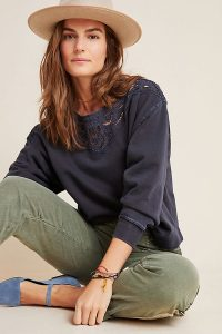Anthropologie Fabienne Eyelet Sweatshirt in Carbon | cut-out detail neckline