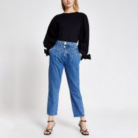 River Island Blue double button slim tapered leg jeans | front stitch detail