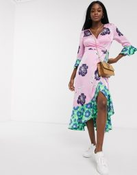 Liquorish contrast hem oversized floral wrap dress in pink and green