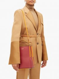 BURBERRY Peggy leather bucket bag in burgundy and orange