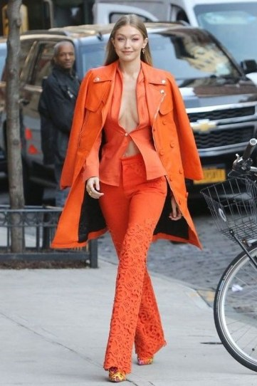 Gigi Hadid rockin this bright orange look - flipped