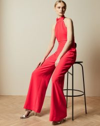 TED BAKER TALLISE Halter neck wide leg jumpsuit in coral / brightly coloured jumpsuits