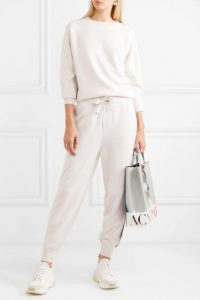 Jennifer Lopez white side stripe tracksuit, OLIVIA VON HALLE Missy Moscow striped silk and cashmere-blend sweatshirt and track pants set, out in Miami, 23 February 2020 | casual celebrity fashion