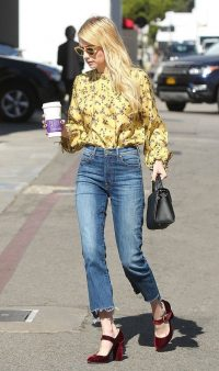 Emma Roberts street style…yellow floral shirt, frayed hem jeans and burgundy velvet Mary Janes