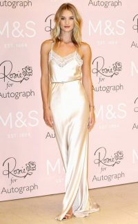 Rosie Huntington-Whiteley's ivory lace trimmed slip dress, worn with a narrow jewelled belt