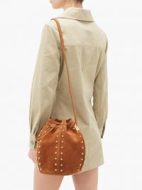 SAINT LAURENT Talitha studded suede bucket bag in tan