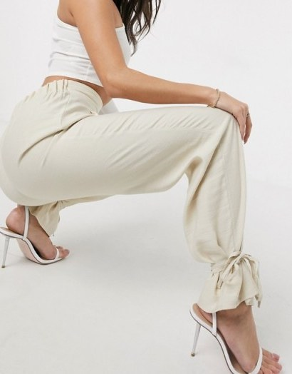 ASOS DESIGN tapered trousers with spaghetti ankle tie detail in sand - flipped