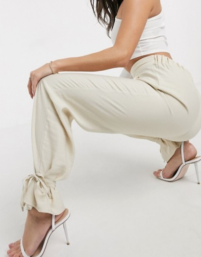 ASOS DESIGN tapered trousers with spaghetti ankle tie detail in sand