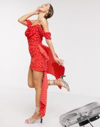 Ruched party dress – In The Style x Jac Jossa exclusive drape off shoulder ruched mini dress with train detail in red polka print