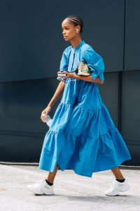 Voluminous blue tiered summer frock and white trainers