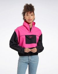 Reebok Vector windbreaker in black and pink