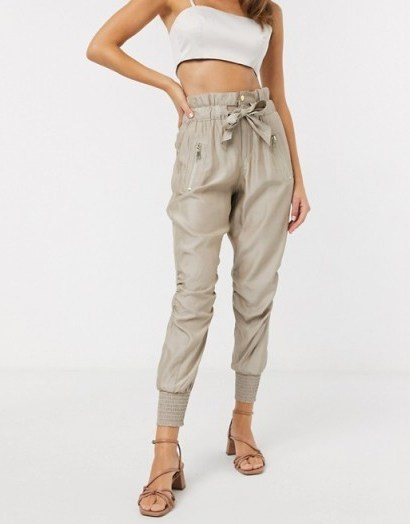 River Island ruched satin tie waist jogger trousers in beige - flipped