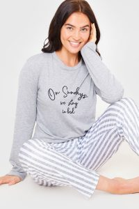 BILLIE FAIERS GREY 'ON SUNDAYS WE STAY IN BED' SLOGAN LONG SLEEVE TOP AND STRIPED TROUSERS PYJAMA SET / slogan pyjamas