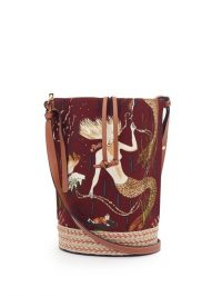 LOEWE PAULA'S IBIZA Gate mermaid-print canvas bucket bag in burgundy | ocean inspired prints | mermaids