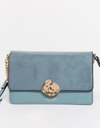 Luella Grey cross body bag in blue with contrast suede front flap and molten gold buckle | crossbody bags